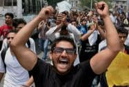 Peoples Democratic Party (PDP) shout slogans during a protest against Israel's attacks on Gaza, in Srinagar