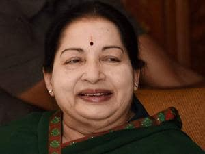 Tamil Nadu Chief Minister and AIADMK Supremo J Jayalalithaa smiles during her address to the party cadres after the party's victory in the Assembly polls