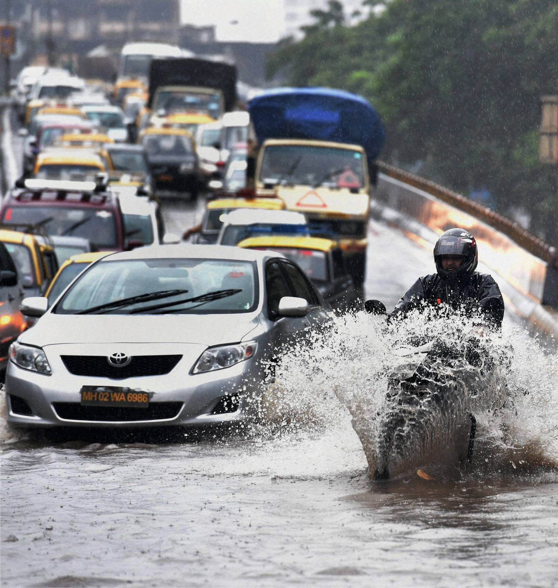 People, wade, flooded, street, heavy, downpour, Mumbai