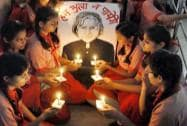 Students light candles to paying tribute to the former President APJ Abdul Kalam