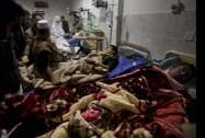 People visit survivors of a Taliban attack on a school at a local hospital in Peshawar