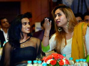 P V Sindhu and Jwala Gutta share light moments during a felicitation ceremony for Rio Olympic 2016