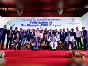 Petroleum Minister Dharmendra Pradhan posea for a group photo with Rio Olympic 2016 players