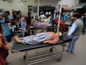 An injured people take first-aid at Govt Medical College hospital