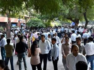 Employees come out of their offices after an earthquake