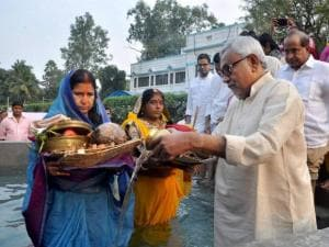 Bihar chief minister Nitish Kumar performs ritual during Chhath festival celebrations