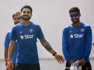 Virat Kohli sharing light moment with Ravindra Jadeja