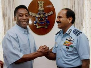Chief of the Air Staff Air Chief Marshal Arup Raha greets Brazilian football legend Pele