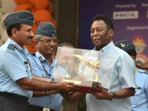 Marshal Arup Raha presenting a memento to Brazilian football legend Pele