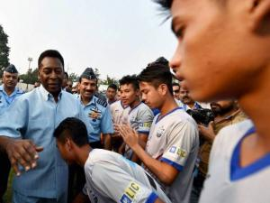 Pele with Chief of the Air Staff Air Chief Marshal Arup Raha meeting Manipur players