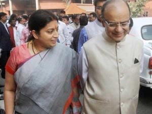 Finance Minister Arun Jaitley with Union HRD Minister Smriti Irani at Parliament during the budget session in New Delhi