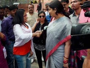 Union HRD Minister Smriti Irani shakes hands with visitors at Parliament in New Delhi