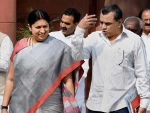 Union HRD Minister Smriti Irani with BJP MP Paresh Rawal outside Parliament during the budget session, in New Delhi
