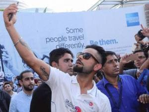 Cricketer Virat Kohli taking selfie