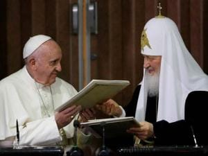 Pope Francis, left, and Russian Orthodox Patriarch Kirill exchange a joint declaration on religious unity