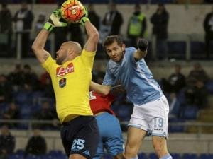 napoli's goalkeeper pepe reina saves on lazio's senad lulic during a serie a soccer match between lazio and napoli at rome's olympic stadium