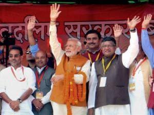 Narendra Modi with Ravishankar Prasad and Upendra Kushwaha