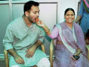 Rabri Devi giving sweet to her son and RJD leader Tejaswi Yadav
