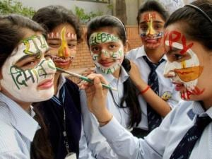 School Children painting their faces during Diwali celebrations