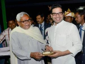 Bihar Chief Minister Nitish Kumar offers prasad to Prashant Kishore