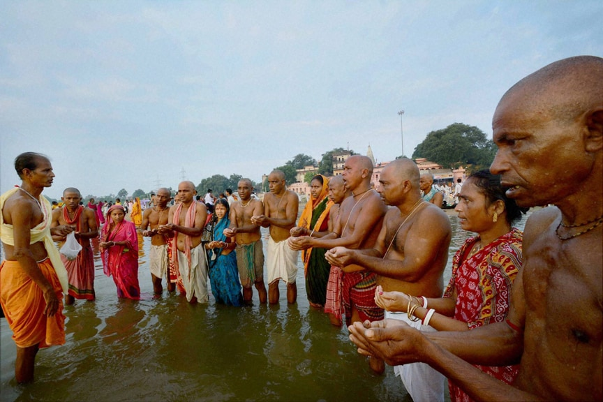 People, perform, pind-daan, salvation, ancestors, Falgu River, first day, Pitrapaksha Mela, Gaya
