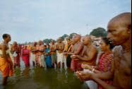People perform 'pind-daan' rituals for salvation of their ancestors at Falgu River