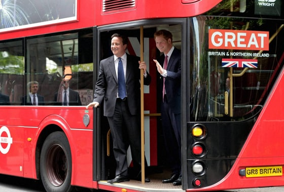 Britain's Prince Harry, right, and Prime Minister David Cameron arrive by New London Bus for the GREAT event, in New York