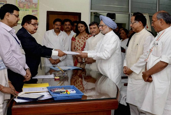 Prime Minister Manmohan Singh submits his nomination papers for Rajya Sabha elections to the Returning Officer at Assam Legislative Assembly in Guwahati