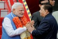 Prime Minister Narendra Modi is welcomed by Mauritius Prime Minister Anerood Jugnauth