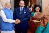 Prime Minister Narendra Modi shakes hand with Mauritius President Rajkeswur Purryag as his wife Aneetah Purryag