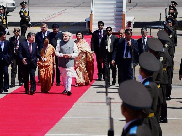 Prime Minister of India, Narendra Modi, India, Uzbekistan, BRICS, SCO Summit, Central Asia, Russia, Uzbekistan Counterpart, Shavkat Mironovich, Tashkent International Airport, Cabinet Colleagues
