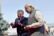 Prime Minister Narendra Modi with Uzbekistan counterpart Shavkat Mironovich