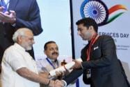 Prime Minister Narendra Modi presents an award to IAS officer and Deputy Commissioner of Kathua, Shahid Iqbal Choudhary