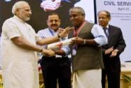 Prime Minister Narendra Modi presents an award to Rajeev N of Kerala