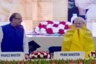Narendra Modi is presented a shawl by Minister of State for Labour and Employment, Bandaru Dattatreya