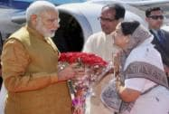 Prime Minister Narendra Modi is received by MP Chief Minister Shivraj Singh and Indore Mayor Malini Gaud