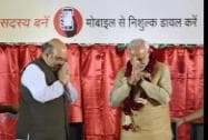 Prime Minister Narendra Modi shakes hands  with  BJP President Amit Shah