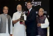 Prime Minister Narendra Modi felicitates Executive Vice President-Manufacturing & Quality of Bosch India, Franz Hauber