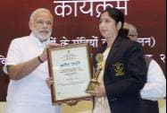 Prime Minister Narendra Modi felicitates Radhika Davi, one of the National  Brand Ambassadors for vocational training