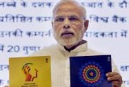 Prime Minister Narendra Modi releasing publications at the launch of Pandit Deendayal Upadhyay Shramev Jayate scheme