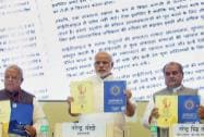 Prime Minister Narendra Modi with Union ministers Narendra Singh Tomar, Kalraj Mishra and Anant Geete releases the brochure