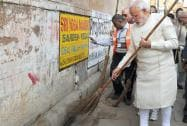 Prime Minister Narendra Modi during a cleanliness drive at Assi Ghat