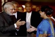 Prime Minister Narendra Modi is greeted upon his arrival at the airport in Colombo