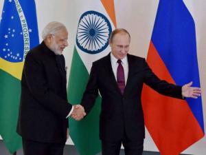 Prime Minister Narendra Modi shakes hand with Russian President Vladimir Putin