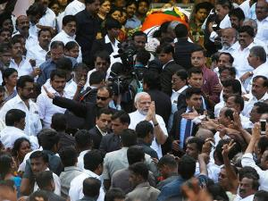 Prime Minister Narendra Modi greets supporters of Tamil Nadu's former Chief Minister Jayaram Jayalalithaa