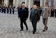 Prime Minister Narendra Modi is escorted by the  French Foreign Minister Laurent Fabius