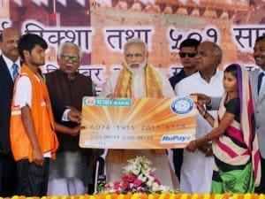 Prime Minister Narendra Modi presents micro-loan cards