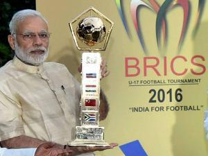 Narendra Modi and unveils BRICS U-17 Football Tournament – 2016 Trophy
