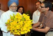 Receives a bouquet from Pulok Chatterjee
