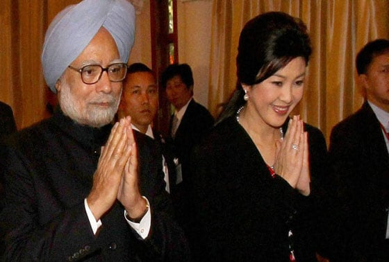Prime Minister Manmohan Singh with his Thailand counterpart Yingluck Shinawatra arrive for the delegation level talks in Bangkok,